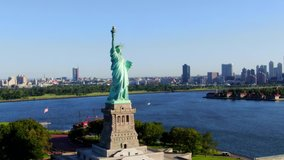 This video shows aerial views of the Statue of Liberty.  The Statue of Liberty is a colossal neoclassical sculpture on Liberty Island in New York Harbor in New York, in the United States.