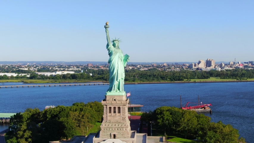 This video shows aerial views of the Statue of Liberty.  The Statue of Liberty is a colossal neoclassical sculpture on Liberty Island in New York Harbor in New York, in the United States. | Shutterstock HD Video #1036327697