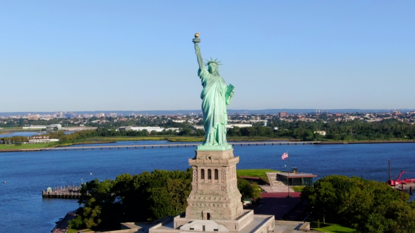 This video shows aerial views of the Statue of Liberty.  The Statue of Liberty is a colossal neoclassical sculpture on Liberty Island in New York Harbor in New York, in the United States. | Shutterstock HD Video #1036327703
