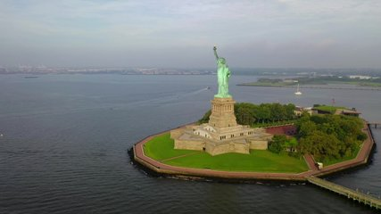 This video shows aerial shots of the Statue of Liberty.  The Statue of Liberty is a colossal neoclassical sculpture on Liberty Island in New York Harbor in New York, in the United States.
