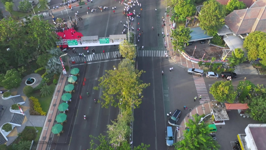 Surabaya, east java - september 1st, 2019.  car free day on raya darmo street in Surabaya on Sunday morning.  aerial drone view of cityscape | Shutterstock HD Video #1036336523