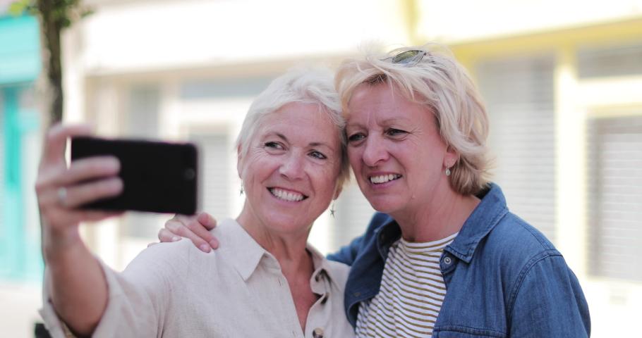 Mature lesbian couple taking selfie on vacation | Shutterstock HD Video #1036351367