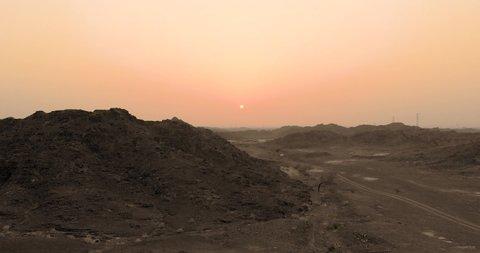 Showka , Fujairah / United Arab Emirates - 06 28 2019: Teenager pilot of a drone aerial shooting the mountains of Fujairah during sunset