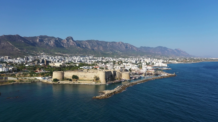 Kyrenia (Girne) is a city on the north coast of Cyprus, known for its cobblestoned old town and horseshoe-shaped harbor.   Shutterstock HD Video #1036395368