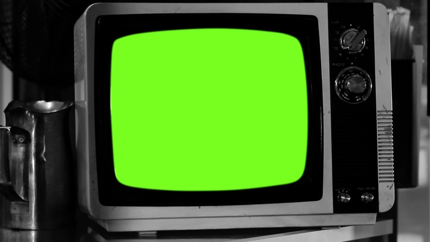 Old Fashioned TV Turns On with Green Screen. Black and White Tone. Zoom In. | Shutterstock HD Video #1036410701