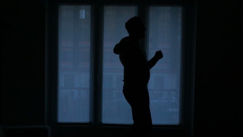 Silhouette of happy man dancing by window, super slow motion 120fps | Shutterstock HD Video #1036416062