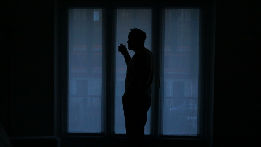 Young man drinking coffee by window at home, slow motion   Shutterstock HD Video #1036416083