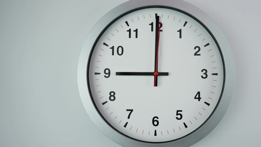 Close up Move the camera angle from left to right, Nine o'clock Start time work, Gray wall clock on  White background, Time Lapse Clock walking 60 minute.