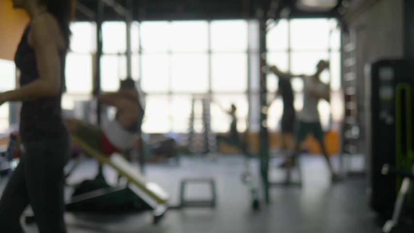 blurred background. people involved in sports in the gym for fitness, interior of new modern equipment, sport concept Royalty-Free Stock Footage #1036456802