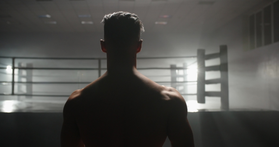 A motivated muay thai sportsman walking towards sparring ring, ready for a fight - martial arts, way to success concept 4k footage