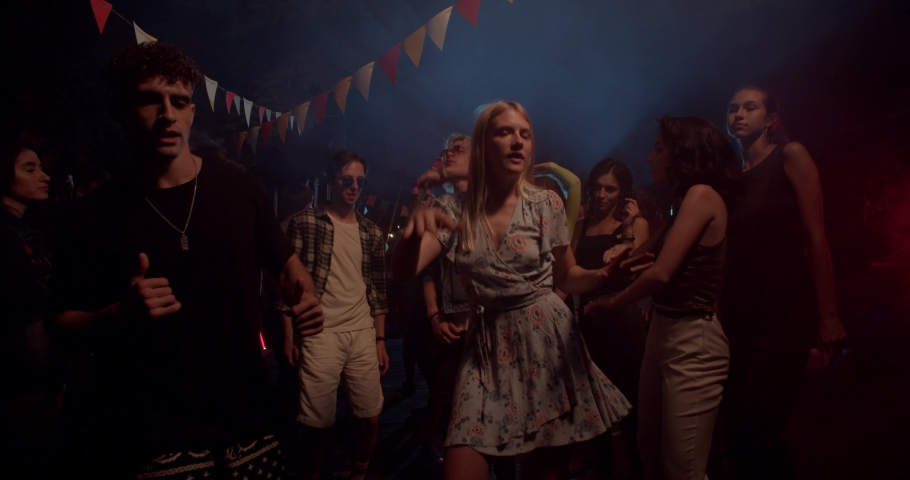 Slow motion at colorful light young multi-ethnic people dance party in different clothes drinking alcohol having fun on weekend laughing sharing socializing celebration close up slow motion | Shutterstock HD Video #1036476908
