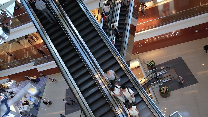 Escalators in modern shopping mall Consumption, sales. Huge modern shopping mall with many staircases. Time lapse | Shutterstock HD Video #1036487018