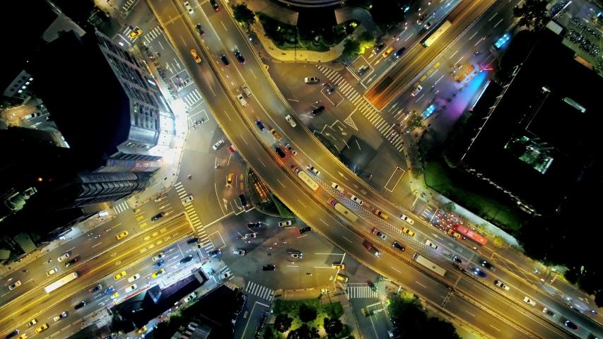 Aerial view of traffic circle - Traffic concept image, gongguan traffic circle birds eye night view use the drone at night in Taipei, Taiwan. | Shutterstock HD Video #1036504925