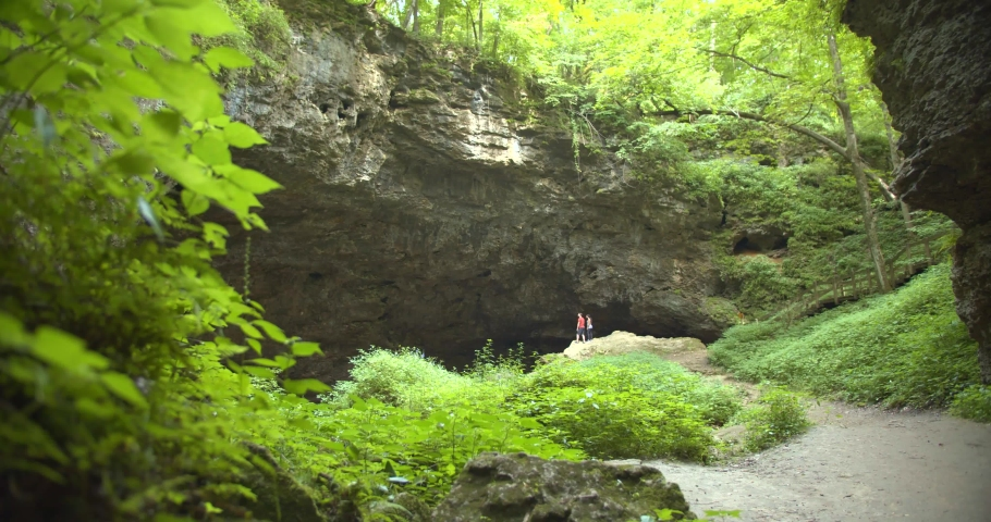 Hikers, Couple at the Entrance to the Maquoketa Caves in Iowa | Shutterstock HD Video #1036529399