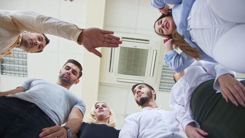 Company of young employees Low Angle View Stacking Hands Together in office Royalty-Free Stock Footage #1036563731