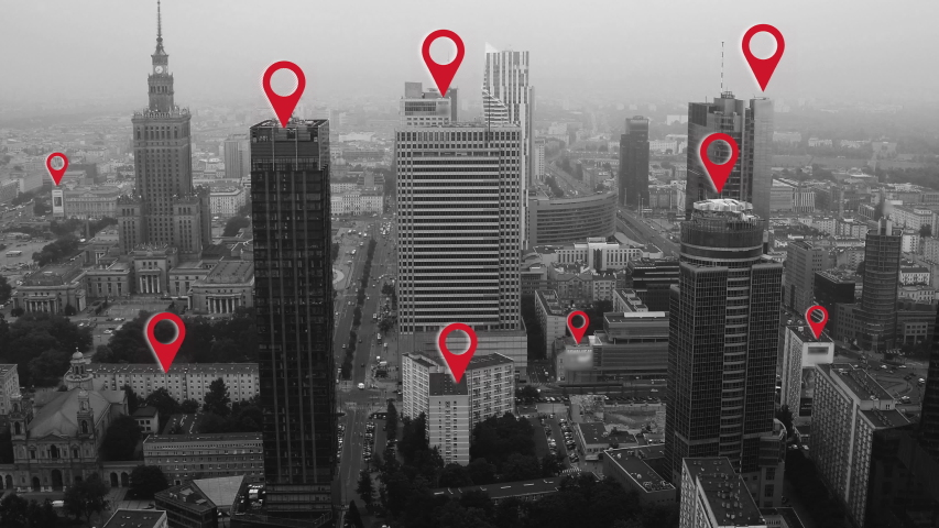 Aerial shot of Warsaw city center with localization icons. #1036566632