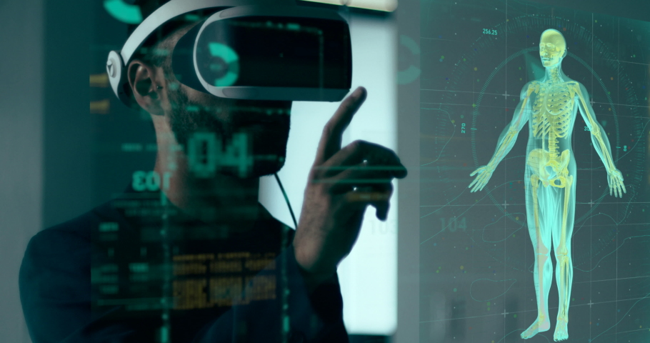 Close-up shot of a surgeon doctor with Augmented Reality VR glasses looking at futuristic medical charts at a high tech hospital.