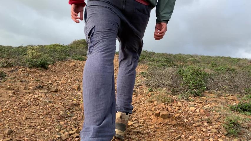 A closeup of a hikers walking feet   Shutterstock HD Video #1036596062