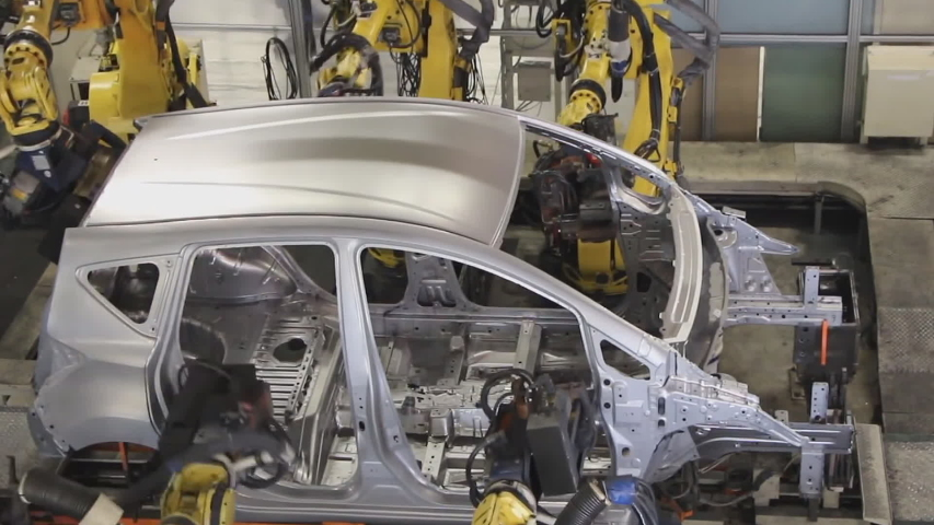 Industrial robots cook a car body