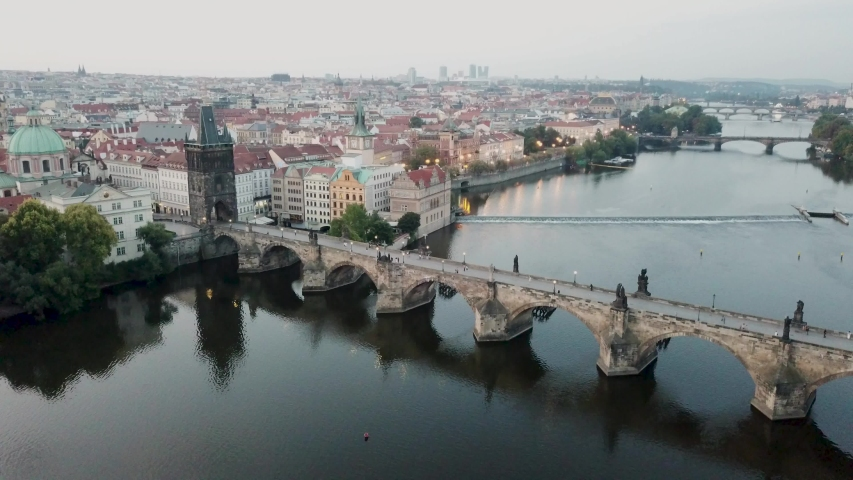 Prague / Czech Republic - 08 25 2018: Aerial footage of Charles Bridge at dawn with overview of the City in Prague | Shutterstock HD Video #1036642643