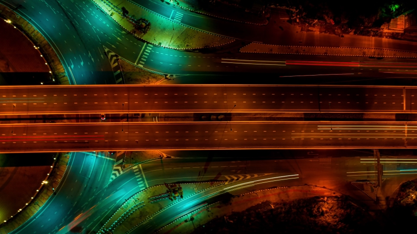 Time lapse expressway top view, Circl Road traffic an important infrastructure in Bangkok Thailand. Road and Roundabout #1036665215