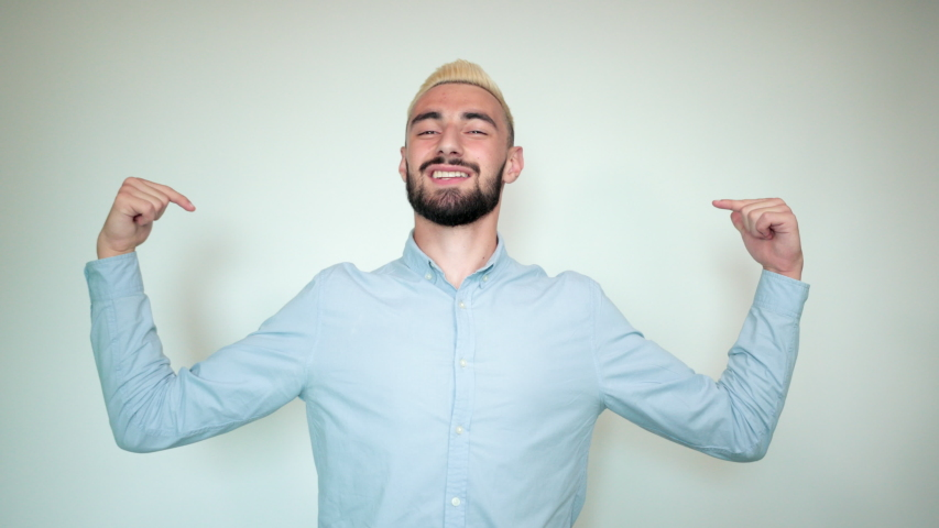 Man with blond hair, black beard over isolated white background shows emotions | Shutterstock HD Video #1036687151