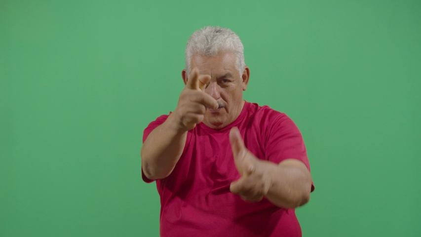 Aggressive adult man executing the viewer with the hand in shape of a gun in ecuador | Shutterstock HD Video #1036693163