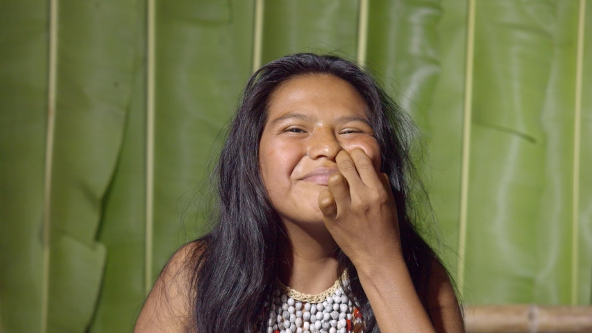 Teenage woman wound exploding looking at the camera in ecuador | Shutterstock HD Video #1036696730