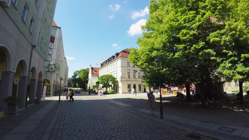 BERLIN, GERMANY - SUMMER 2018: Ancient narrow street in central Berlin, Germany. Old town. Architecture, old houses, streets and neighborhoods. Shot in 4K (ultra-high definition (UHD)).