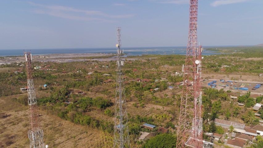 Aerial view cell phone towers line in bali, indonesia. Telecommunication tower, communication antenna on coast sea | Shutterstock HD Video #1036699994