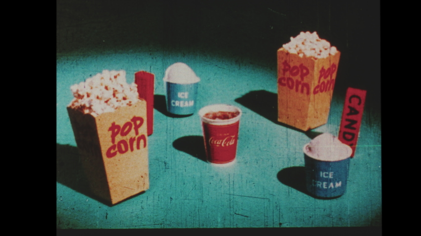1960s  Animated Snack-Bar Advertisement that was Featured at Drive In Theater. A Young Boy Excited About the Pop Corn, Hot Dogs, Ice Cream and Coca-Cola from the Refreshment Counter at Intermission.