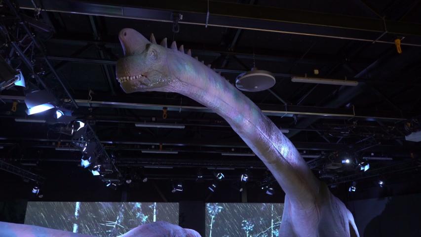 VANTAA, FINLAND - JUNE 10,2019: Children and adults see interactive models of dinosaurs. Children's educational entertainment science Museum Eureka (Heureka) #1036707584