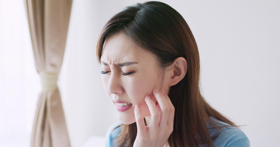 Asian beauty woman has dry skin and scratching her face | Shutterstock HD Video #1036713698