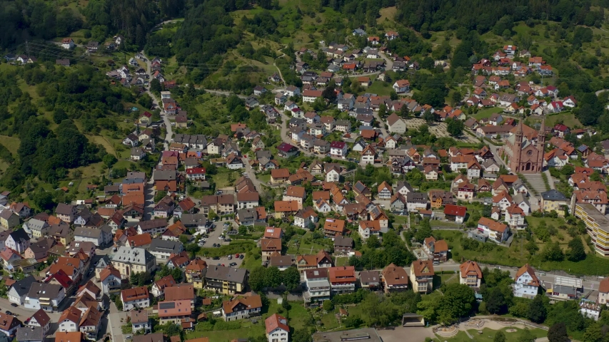 Aerial view of the city Forbach in Germany, on a sunny day in summer. Round pan to the left with wide view. | Shutterstock HD Video #1036729472