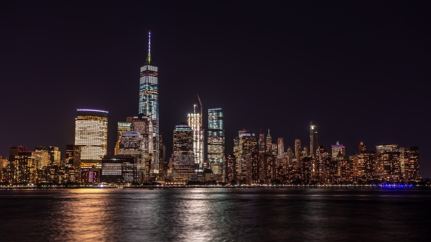 New York, USA - September 22, 2016 : Lower Manhattan, Wall Street view from New Jersey time lapse at night | Shutterstock HD Video #1036737470