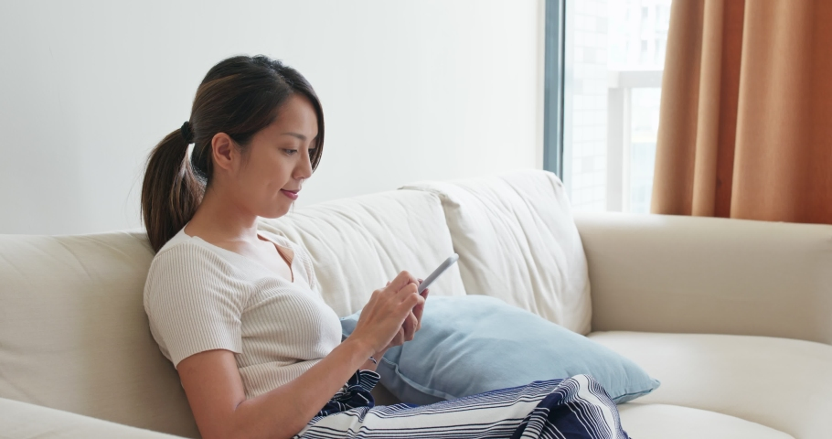Woman use of mobile phone at home #1036750721