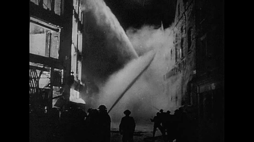 CIRCA 1940s - The British Fire Brigade pumps water from the River Thames to combat fires after a Nazi air raid, during World War 2, in 1940.