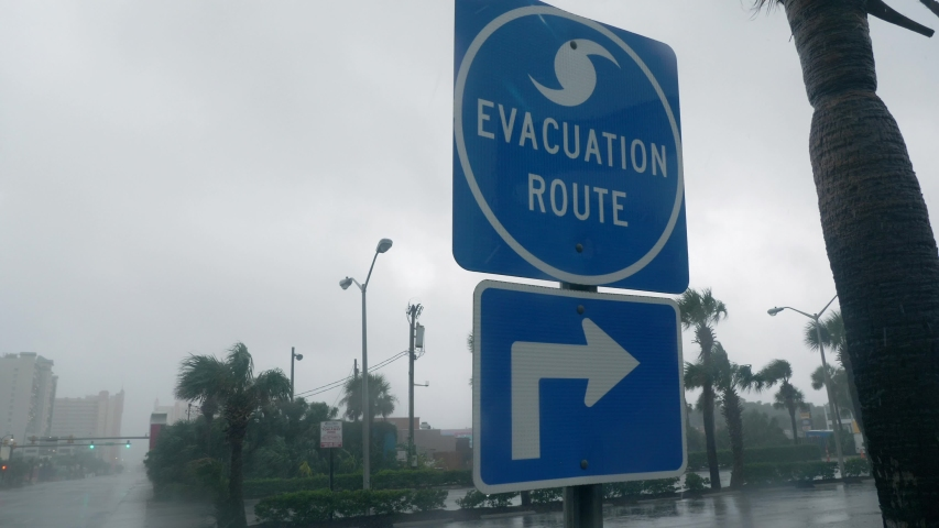Myrtle Beach, South Carolina / USA - September 5, 2019: Hurricane Dorian Strong Winds Blow Evacuation Sign Royalty-Free Stock Footage #1036761824
