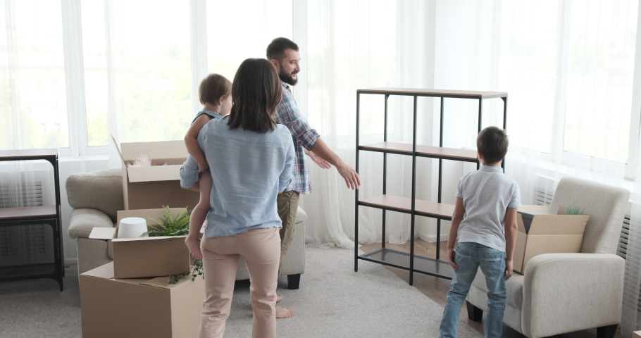 Happy family moving into new house | Shutterstock HD Video #1036775558