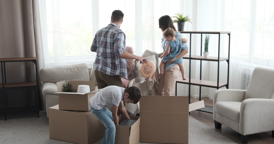Family moving into new house | Shutterstock HD Video #1036775576
