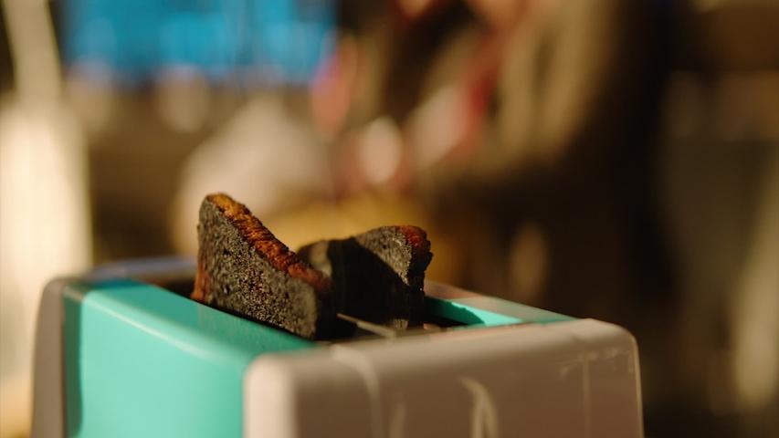 Burnt bread in a toaster. | Shutterstock HD Video #1036820087