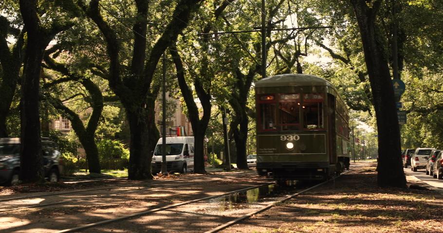 New Orleans, Louisiana - June 18, 2019: Passengers ride the historic streetcar along Saint Charles Avenue in the Garden District of New Orleans Louisiana USA