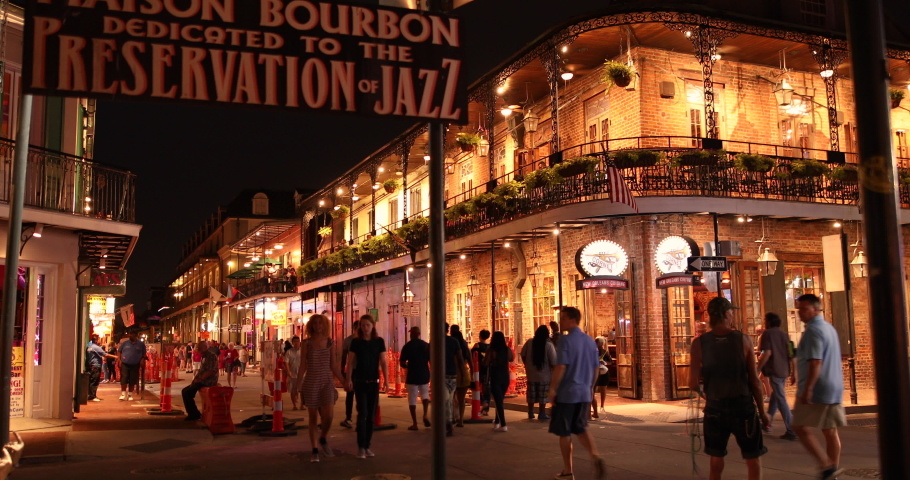 New Orleans, Louisiana - June 16, 2019: Crowds of people party and walk by the famous Preservation Hall Jazz Bar along the French Quarter and restaurants on Bourbon Street New Orleans Louisiana USA