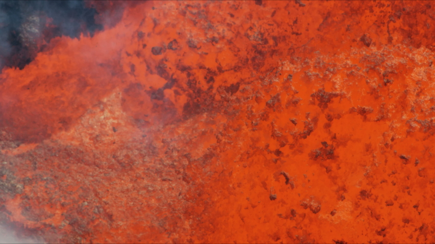 Aerial view of erupting hot liquid lava rock spewing from below the earths surface a natural unstoppable active volcano RED WEAPON   Shutterstock HD Video #1036834451