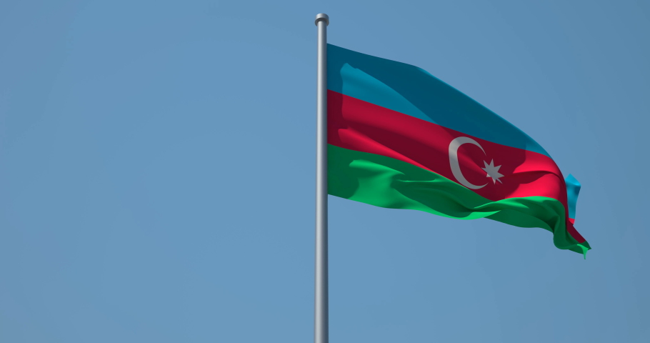 Azerbaijan flag on flagpole. 4K 60fps. Baku. Azerbaijan Flag in Slow Motion. Azerbaijan flag waving in wind. Great for History, presentation with texts and corporate projects.