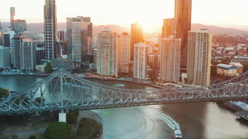 Perfect real estate closing shot - Brisbane city sunset from the sky with Story Bridge and buildings behind