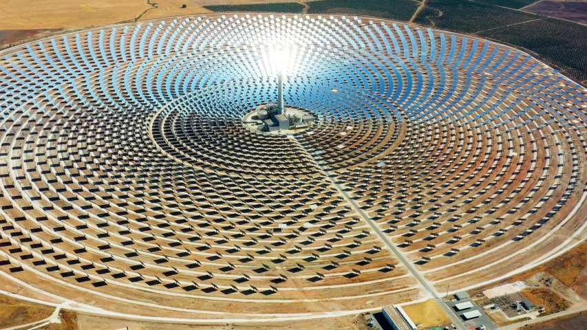 Modern solar power station with tower in aerial view, Concentrated solar power tower, solar farm center
