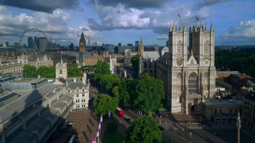 Aerial view of London including Westminster Abbey and Big Ben. Major sights included in this view are Big Ben and Houses of Parliament, the London Eye, Shard, Canary Wharf and the Supreme Court | Shutterstock HD Video #1036868753
