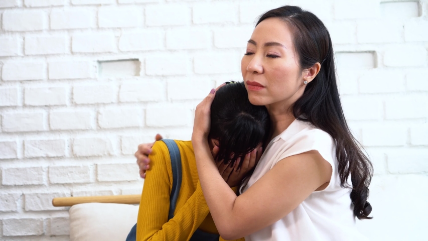 Asian Mother Comforting Crying Teenage Stock Footage Video (100%  Royalty-free) 1036875026   Shutterstock
