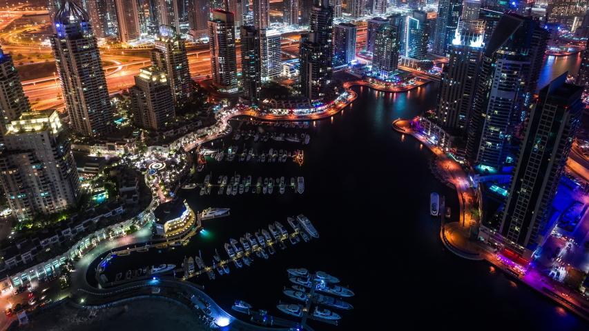 Dubai Marina & Yacht club at Jumeirah Beach in Dubai, United Arab Emirates time lapse at night zoom out